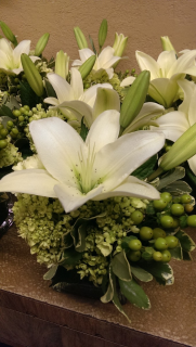 White lilies and greens